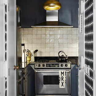 Small scandinavian enclosed kitchen ideas - Inspiration for a small scandinavian u-shaped slate floor enclosed kitchen remodel in New York with beige backsplash, stainless steel appliances, no island, raised-panel cabinets, gray cabinets, granite countertops and ceramic backsplash