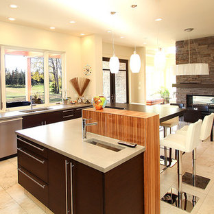 Contemporary eat-in kitchen ideas - Trendy l-shaped eat-in kitchen photo in Edmonton with an undermount sink, flat-panel cabinets, dark wood cabinets, concrete countertops, green backsplash, glass sheet backsplash and stainless steel appliances