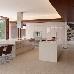 Modern eat-in kitchen designs - Minimalist eat-in kitchen photo in San Francisco with flat-panel cabinets, white cabinets and white appliances