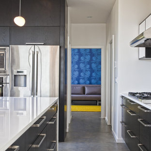 Example of a minimalist kitchen design in Seattle with stainless steel appliances