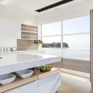 Inspiration for a large modern single-wall eat-in kitchen in New York with an integrated sink, flat-panel cabinets, white cabinets, quartz benchtops, white splashback, stone slab splashback, panelled appliances, porcelain floors and with island.