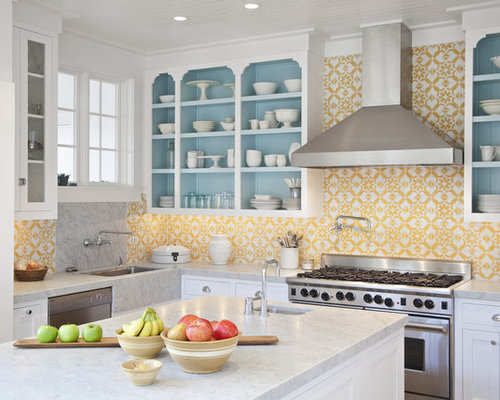 Example Of A Transitional Kitchen Design In Miami With White Cabinets,  Yellow Backsplash, Stainless