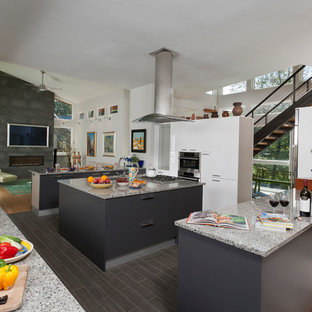 Large modern eat-in kitchen designs - Example of a large minimalist eat-in kitchen design in Boston with gray cabinets, granite countertops and two islands