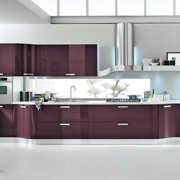 Modern purple kitchen with curved cabinets