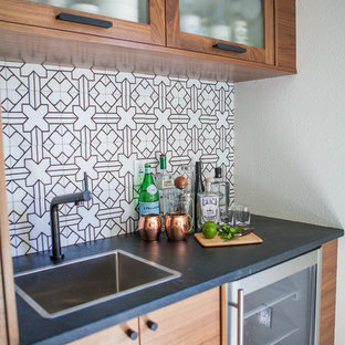 Design ideas for a small midcentury l-shaped open plan kitchen in San Francisco with medium wood cabinets, soapstone benchtops, multi-coloured splashback, ceramic splashback, porcelain floors, white floor, a farmhouse sink, flat-panel cabinets, stainless steel appliances and with island.