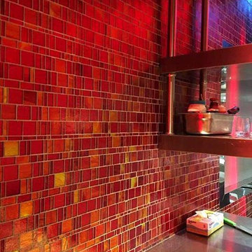 Modern red kitchen with mosaic tile