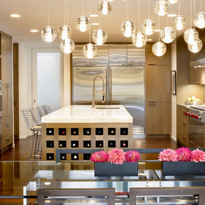 Mid-sized trendy u-shaped dark wood floor open concept kitchen photo in Chicago with flat-panel cabinets, light wood cabinets, stainless steel appliances, an undermount sink, marble countertops, beige backsplash and an island