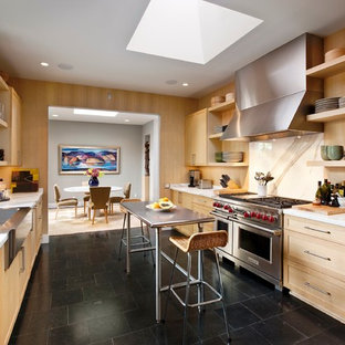 Design ideas for a contemporary separate kitchen in Santa Barbara with stainless steel appliances, a drop-in sink, open cabinets, light wood cabinets, marble benchtops, white splashback, stone slab splashback and black floor.
