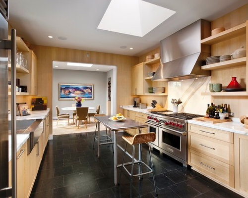 1950s Black Floor Enclosed Kitchen Photo In Santa Barbara With Stainless  Steel Appliances, A Drop