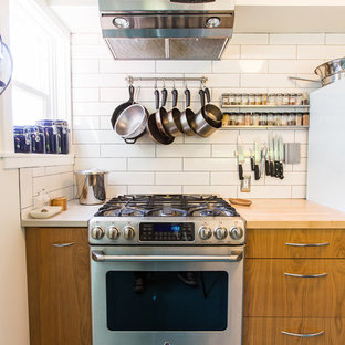 Photo of a small midcentury kitchen in Seattle with linoleum floors and blue floor.