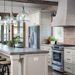 Mid-sized rustic open concept kitchen remodeling - Mid-sized mountain style galley medium tone wood floor open concept kitchen photo in Birmingham with a farmhouse sink, shaker cabinets, white cabinets, concrete countertops, red backsplash, stainless steel appliances and an island