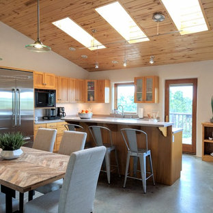 Mid-sized southwestern eat-in kitchen ideas - Eat-in kitchen - mid-sized southwestern u-shaped concrete floor and gray floor eat-in kitchen idea in Other with a double-bowl sink, medium tone wood cabinets, terrazzo countertops, stainless steel appliances, an island and gray countertops