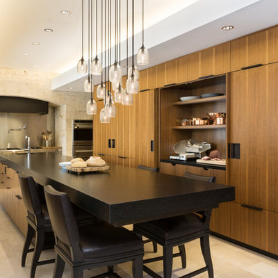Eat-in kitchen - large contemporary single-wall porcelain tile eat-in kitchen idea in New York with granite countertops, flat-panel cabinets, medium tone wood cabinets, stainless steel appliances, an undermount sink and an island