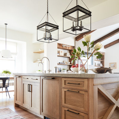 Example of a mid-sized tuscan medium tone wood floor and brown floor open concept kitchen design in San Francisco with a single-bowl sink, shaker cabinets, light wood cabinets, quartzite countertops, multicolored backsplash, ceramic backsplash, paneled appliances, an island and beige countertops