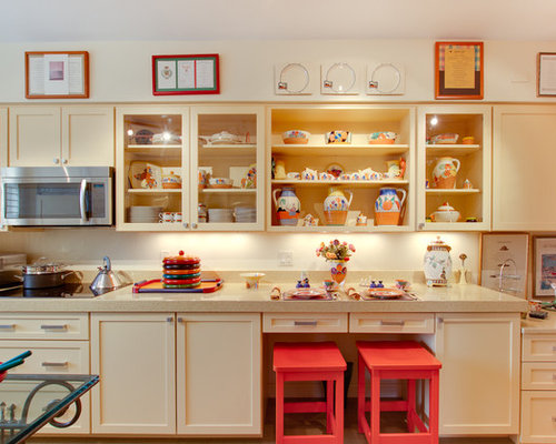 Eclectic Galley Kitchen Idea In DC Metro With Glass Front Cabinets And  Yellow Cabinets