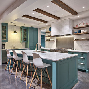 Large farmhouse kitchen remodeling - Large farmhouse u-shaped concrete floor kitchen photo in Austin with an undermount sink, marble countertops, white backsplash, ceramic backsplash, stainless steel appliances, an island, shaker cabinets and turquoise cabinets