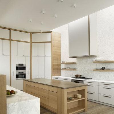 Trendy kitchen photo in Austin with mosaic tile backsplash, stainless steel appliances, white backsplash, flat-panel cabinets and white cabinets