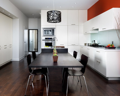 Inspiration For A Contemporary Kitchen Remodel In Toronto With Flat Panel Cabinets White