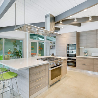 Modern eat-in kitchen appliance - Inspiration for a modern l-shaped eat-in kitchen remodel in Orange County with an undermount sink, flat-panel cabinets, light wood cabinets, paneled appliances, an island and white countertops