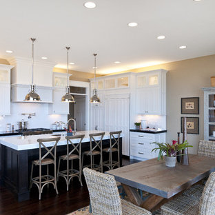 Large traditional eat-in kitchen ideas - Large elegant l-shaped dark wood floor eat-in kitchen photo in Salt Lake City with shaker cabinets, subway tile backsplash, an undermount sink, white cabinets, marble countertops, white backsplash, stainless steel appliances and an island