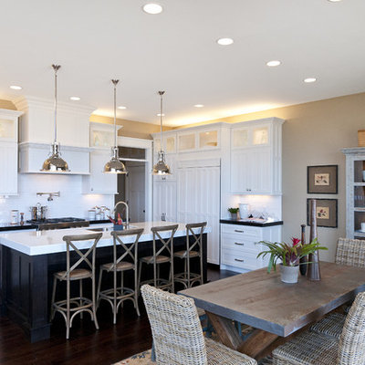 Large elegant l-shaped dark wood floor eat-in kitchen photo in Salt Lake City with shaker cabinets, subway tile backsplash, an undermount sink, white cabinets, marble countertops, white backsplash, stainless steel appliances and an island