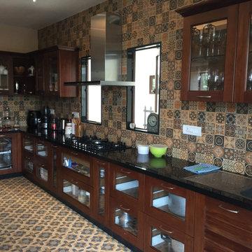 Modular Kitchen in Teak wood by Hoop Pine