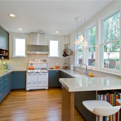 Kitchen - modern u-shaped kitchen idea in Other with flat-panel cabinets, blue cabinets, white appliances, a single-bowl sink, white backsplash and porcelain backsplash