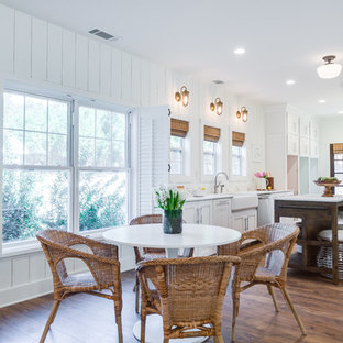 Mid-sized farmhouse eat-in kitchen ideas - Mid-sized country u-shaped light wood floor and beige floor eat-in kitchen photo in Orange County with a farmhouse sink, shaker cabinets, white cabinets, quartz countertops, white backsplash, stainless steel appliances, an island and white countertops