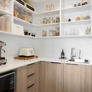 Large contemporary single-wall eat-in kitchen in Melbourne with a double-bowl sink, open cabinets, white cabinets, white splashback, dark hardwood floors, black floor and white benchtop.