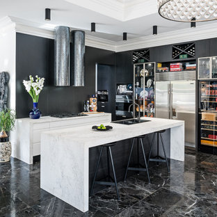 Design ideas for a mid-sized contemporary l-shaped open plan kitchen in Melbourne with a double-bowl sink, flat-panel cabinets, black cabinets, marble benchtops, black splashback, stone slab splashback, stainless steel appliances, marble floors, with island, black floor and white benchtop.
