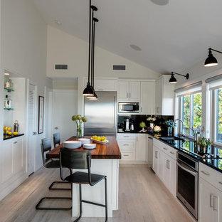 Kitchen - beach style light wood floor kitchen idea in New York with an island