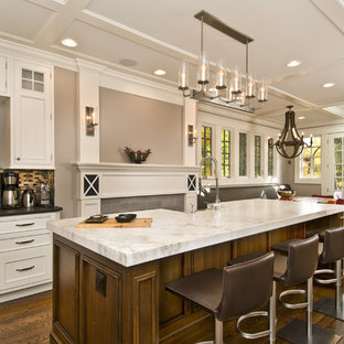 Design ideas for a traditional eat-in kitchen in Newark with beige cabinets.