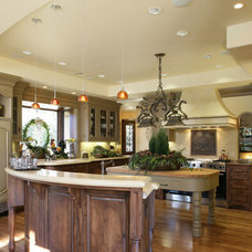 Rustic Kitchen by Conrado - Home Builders