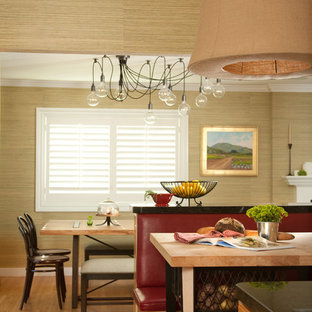 Eclectic eat-in kitchen in Santa Barbara with medium wood cabinets, medium hardwood floors and with island.