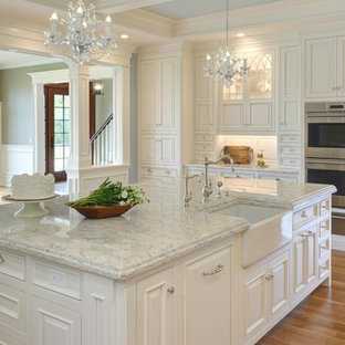 Large traditional enclosed kitchen designs - Large elegant l-shaped light wood floor and brown floor enclosed kitchen photo in Bridgeport with a farmhouse sink, beaded inset cabinets, white cabinets, marble countertops, gray backsplash, mosaic tile backsplash, paneled appliances and an island