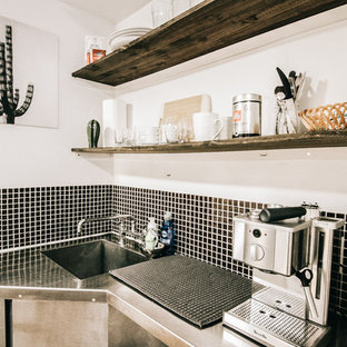 Small tropical kitchen appliance - Small island style kitchen photo in Montreal with open cabinets, dark wood cabinets and stainless steel countertops