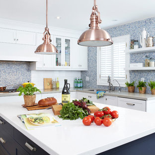 Inspiration for a contemporary kitchen in Toronto with mosaic tiled splashback, blue splashback, shaker cabinets, white cabinets and engineered stone countertops.