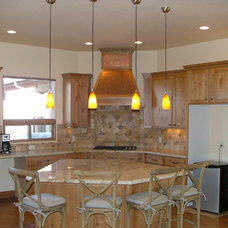 Eclectic Kitchen by Capistrano Homes and Landscaping, LLC.