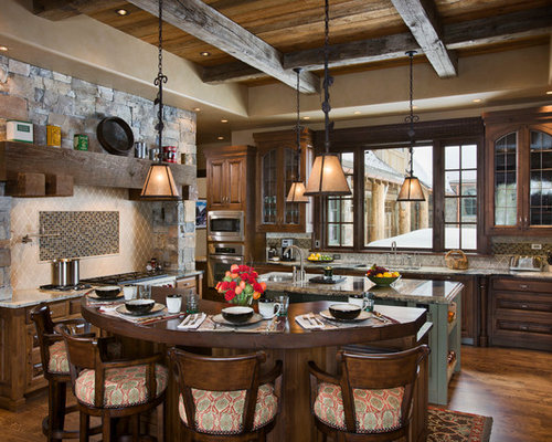 Inspiration For A Rustic U Shaped Eat In Kitchen Remodel In Other With  Raised