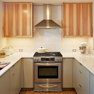 Contemporary enclosed kitchen remodeling - Example of a trendy enclosed kitchen design in Austin with quartz countertops, flat-panel cabinets, medium tone wood cabinets and stainless steel appliances