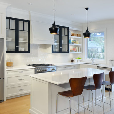 Kitchen - mid-sized traditional l-shaped light wood floor kitchen idea in Toronto with an undermount sink, recessed-panel cabinets, quartz countertops, white backsplash, porcelain backsplash, stainless steel appliances and an island