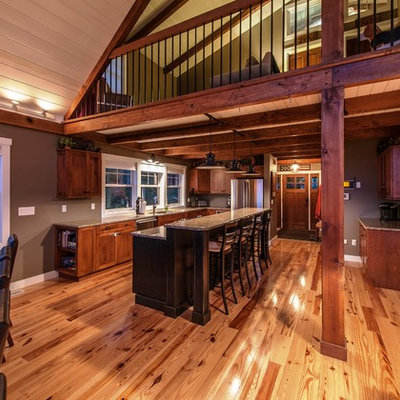 Large mountain style l-shaped light wood floor eat-in kitchen photo in Portland Maine with an undermount sink, flat-panel cabinets, medium tone wood cabinets, granite countertops, stainless steel appliances and an island