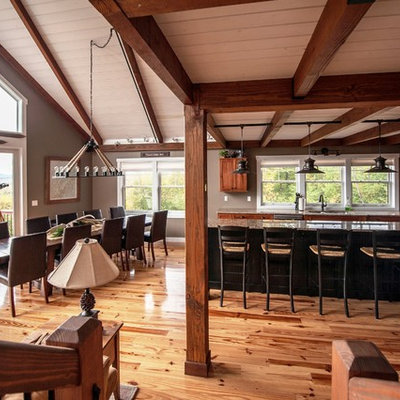 Example of a large mountain style l-shaped light wood floor eat-in kitchen design in Portland Maine with an undermount sink, flat-panel cabinets, medium tone wood cabinets, granite countertops, stainless steel appliances and an island