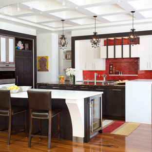 This is an example of a contemporary eat-in kitchen in Denver with red splashback, stainless steel appliances, shaker cabinets, quartz benchtops, medium hardwood floors, multiple islands, white benchtop and coffered.