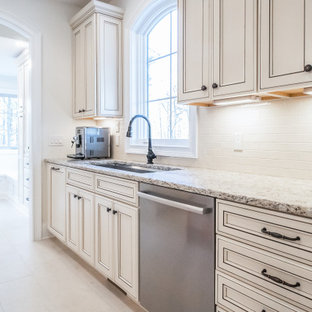 Large french country eat-in kitchen remodeling - Eat-in kitchen - large french country beige floor eat-in kitchen idea in Cleveland with a double-bowl sink, beige cabinets, beige backsplash, stainless steel appliances and multicolored countertops