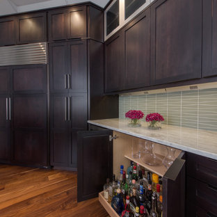 This is an example of a contemporary kitchen in Denver with shaker cabinets, dark wood cabinets, marble benchtops, blue splashback, glass tile splashback and stainless steel appliances.