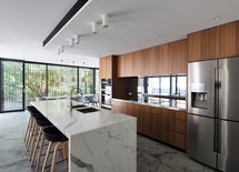 Love the cabinets!  What is wood?