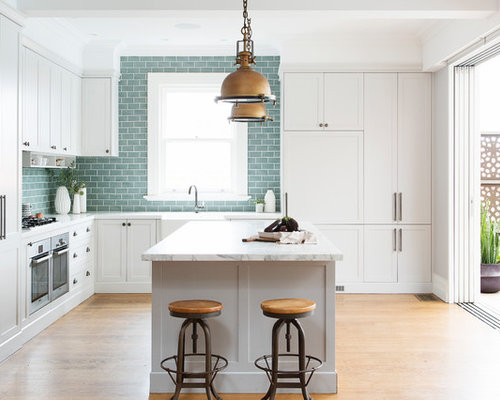 Transitional L Shaped Kitchen In Sydney With A Farmhouse Sink, Shaker  Cabinets, White