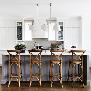 Transitional galley eat-in kitchen in Sydney with recessed-panel cabinets, white cabinets, dark hardwood floors, with island, brown floor, an undermount sink, subway tile splashback, white appliances and white benchtop.