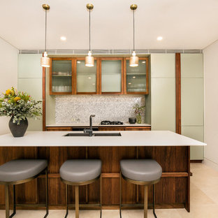 Design ideas for a mid-sized contemporary kitchen in Sydney with a double-bowl sink, glass-front cabinets, with island, beige floor and white benchtop.